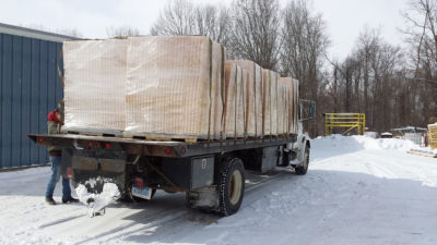A large Michigan commercial beekeeper picks up 12 skids of unassembled Beeline woodenware.