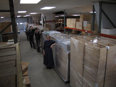 Beeline staff prepares to ship 15 skids of beekeeping supplies to a Canada dealer.